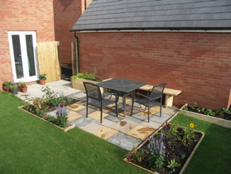 Concrete slab patio seating area, new-build back garden